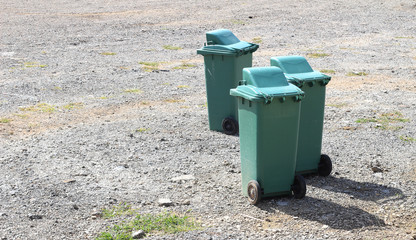 Old green bins on the street.