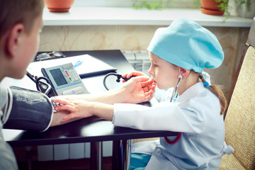 Young female doctor or nurse taking  patients