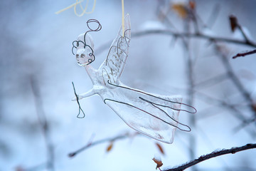 Glass angel in winter background. Fused glass craft work, religion symbol, Christmas decoration.