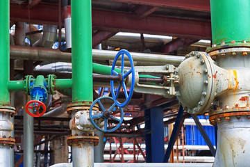 Pipes with a shut-off valve at a chemical plant close up