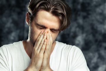 Portrait of the tired sad man
