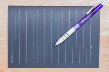 image of a notebooks and pencil on the desk, close-up