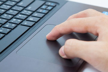 Close-up of male hands on laptop keyboard