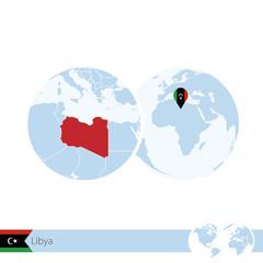 Libya on world globe with flag and regional map of Libya.