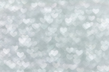 defocused abstract white hearts light background