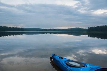 Blue kayak floating on still water
