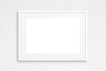 Blank photo frame mock up, on white textured wall