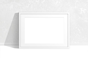 Blank photo frame mock up near the wall with new modern wallpaper