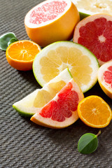 Citrus set of grapefruits and tangerines on a concrete gray back