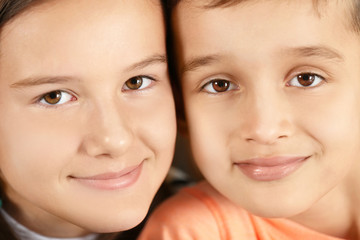 Portrait of small boy and girl