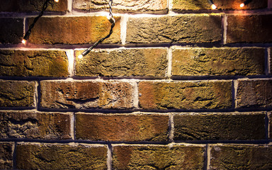 brick wall background with lights glowing