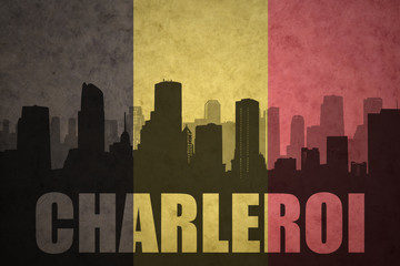 abstract silhouette of the city with text Charleroi at the vintage belgian flag