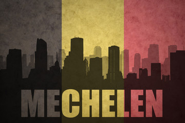 abstract silhouette of the city with text Mechelen at the vintage belgian flag