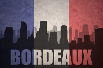 abstract silhouette of the city with text Bordeaux at the vintage french flag