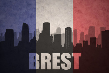 abstract silhouette of the city with text Brest at the vintage french flag