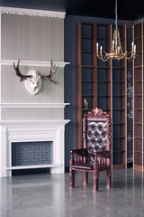 Christmas scenery. Luxury interior of home library. Sitting room with elegant furniture. Victorian stile