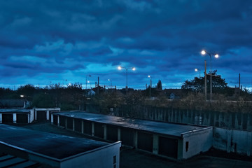 Chomutov, Ustecky kraj, Czech republic - November 17, 2016: dark blue sky above the garages and road number 13 during the upcoming evening
