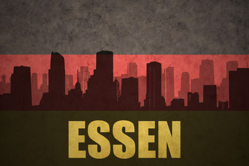 abstract silhouette of the city with text Essen at the vintage german flag