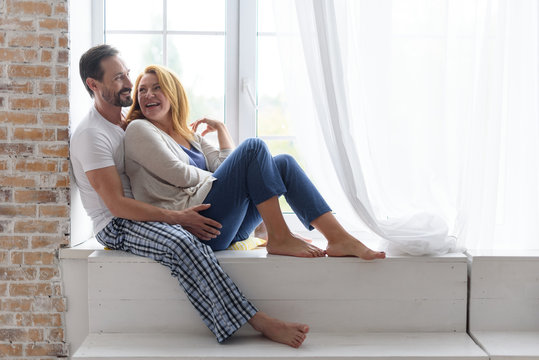Adult happy couple smiling at home