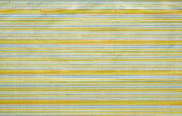 background of the fabric and textile drawings bands and lines yellow and green