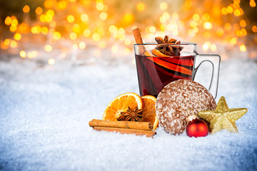 hot spiced wine on christmas xmas market  snow bokeh background with many lights ice blue  snow