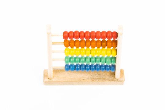 Traditional abacus with colorful wooden beads on white background. Toy abacus to learn counting. Colorful children counting frame for kids. Top side view.
