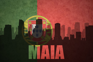 abstract silhouette of the city with text Maia at the vintage portuguese flag