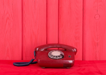 Vintage red phone on a red background