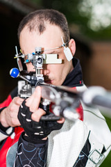 Sport shooting. Man practicing for competition sport shooting with free rifle