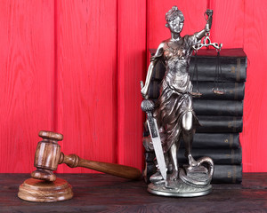 justice, judicial hammer, statuette of Themis, the books, the law