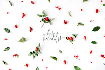 words happy holidays and minimal creative berry arrangement pattern on white. flat lay, top view. christmas background wallpaper.