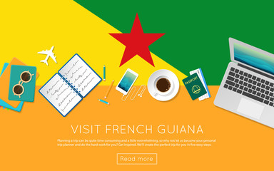 Visit French Guiana concept for your web banner or print materials. Top view of a laptop, sunglasses and coffee cup on French Guiana national flag. Flat style travel planninng website header.