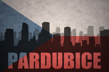 abstract silhouette of the city with text Pardubice at the vintage czech republic flag