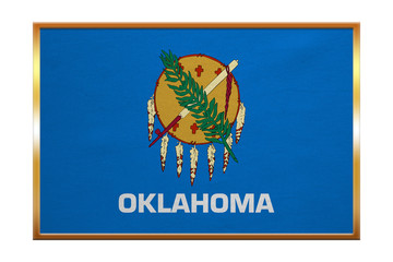 Flag of Oklahoma , golden frame, fabric texture