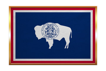 Flag of Wyoming , golden frame, fabric texture