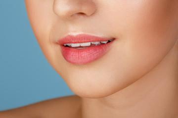 Perfect natural lip makeup. Close up macro photo with beautiful female mouth. Plump full lips. Close-up face detail. Perfect clean skin, light fresh lip make-up. Beautiful spa tender lip