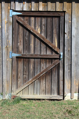Weathered wood door to a barn stall