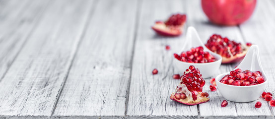 Wooden table with Pomegranate (selective focus)