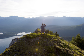 Young man taking picture at sunrise in nature