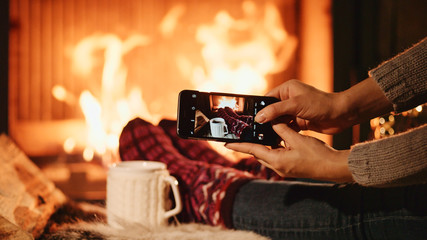 Unrecognizable Woman Hands Taking Cozy Picture on the SmartPhone