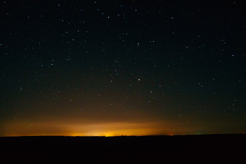 Night glow and a starry sky