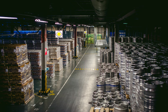 Interior warehouse. pallets with bottles stand in rows stock