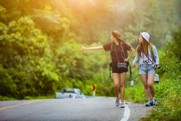 The tourist asian women travel in the middle of nature the car w