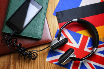 headphones and flag on a wooden background