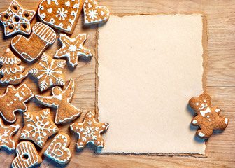 Christmas cookies with paper on wooden table. Merry Christmas and Happy New Years eve! Top view