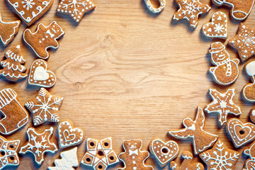 Christmas gingerbread on wooden table. Top view. Christmas frame background. Copy space for your text