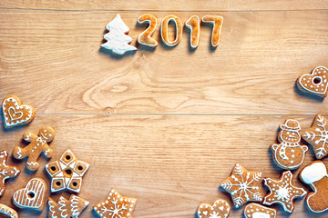 Merry Christmas and Happy new year! Homemade cookies on wooden background. Top view. Copy space for your text