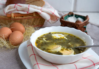 Lunch with soup, bread and eggs in rustic style