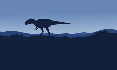 Silhouette of mapusaurus on desert scenery