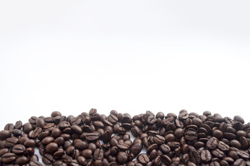 coffee beans on white background. subject soft focus